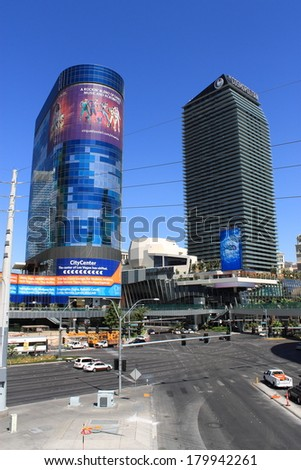 LAS VEGAS - JULY 3: The famous Strip featuring the Cosmopolitan Hotel and Casino on July 3, 2012 in Las Vegas, Nevada. The Las Vegas Strip is an approximately 4 mile stretch of Las Vegas Boulevard. - stock photo
