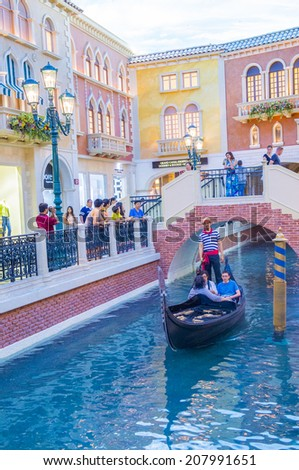 LAS VEGAS - JULY 03 : The interior of the Venetian hotel and replica of the Grand canal in Las Vegas  on July 03, 2014. With more than 4000 suites it's one of the most famous hotels in the world. - stock photo