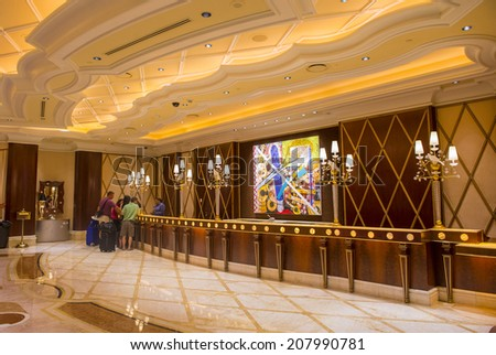 LAS VEGAS - JULY 21 : The main lobby at the Wynn Hotel and casino in Las vegas on July 21 2014. The hotel has 2,716 rooms and opened in 2005. - stock photo