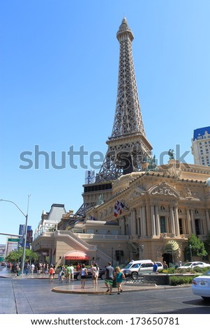 LAS VEGAS - JULY 3: The Paris Hotel and Casino on July 3, 2012 in Las Vegas, Nevada. Opened in 1999, it has 2,915 rooms and features replicas of the Eiffel Tower and Montgolfier Balloon. - stock photo
