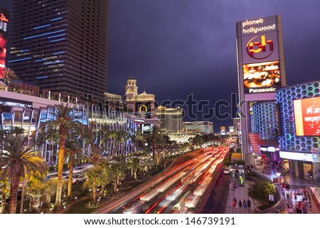 LAS VEGAS - JULY 19, - Vegas Strip on July 19, 2013 in Las Vegas. A Bolt of lightening lights up the clouds on the Vegas strip during a storm which caused flooding and wind damage. - stock photo