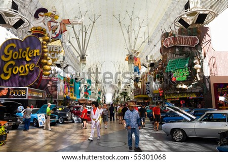 LAS VEGAS - JUNE 4: Fremont Street in Las Vegas on June 4, 2010. The street is the second most famous street in the Las Vegas. Fremont Street dates back to 1905, when Las Vegas itself was founded. - stock photo
