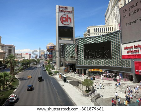 LAS VEGAS - JUNE 29: Planet Hollywood Hotel Miracle Mile and Paris hotel with cloudy sky Las Vegas Boulevard on June 29, 2015 in Las Vegas.  - stock photo