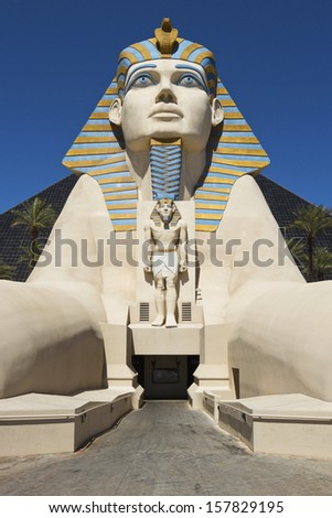 LAS VEGAS - JUNE 26: Replica of Great Sphinx in front of Luxor Hotel and Casino, the most recognizable hotel on Vegas strip, because of its striking design, JUNE 26, 2013 in Las Vegas, Nevada, USA    - stock photo