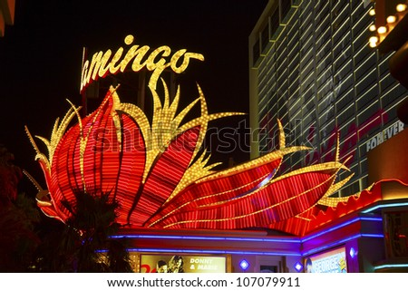 LAS VEGAS - JUNE 15: the famous Flamingo Hotel at night on June 15, 2012 in LAS VEGAS, USA.  Bugsy Siegel opened the Flamingo in 1946 as the third casino in Las Vegas. - stock photo