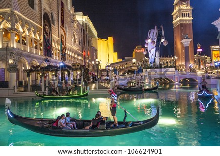LAS VEGAS - JUNE 15: The Venetian Resort Hotel & Casino on June 15, 2012. The resort opened on May 3, 1999 with flutter of white doves, sounding trumpets, singing gondoliers and actress Sophia Loren. - stock photo