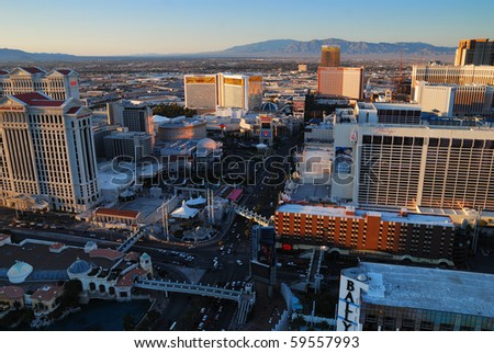 LAS VEGAS - MAR 4: City skyline at sunset marking the start of the fabulous night life of the city, March 4, 2010 in Las Vegas, Nevada. - stock photo