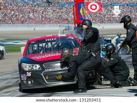 LAS VEGAS - MAR 10: JJ Yeley during a pit stop at the Nascar Kobalt 400 in Las Vegas, NV on Mar 10, 2013 - stock photo
