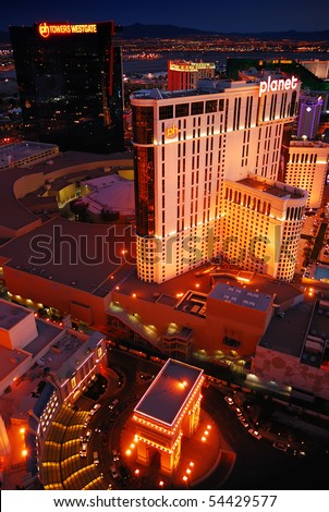 LAS VEGAS - MAR 4: Planet Hollywood and Paris Las Vegas illuminated after sunset marking the start of the fabulous night life of the city on March 4, 2010 in Las Vegas, Nevada. - stock photo