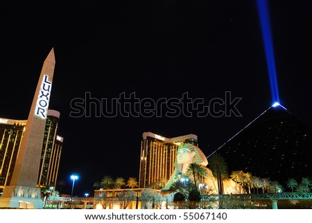 LAS VEGAS - MAR 4: The Luxor, among the most recognizable hotels on the popular Vegas strip because of its striking design and bright light., at night on March 4, 2010 in Las Vegas, Nevada. - stock photo