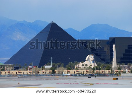 LAS VEGAS - MAR 4: The Luxor, among the most recognizable hotels on the popular Vegas strip because of its striking design and bright light. March 4, 2010 in Las Vegas, Nevada. - stock photo