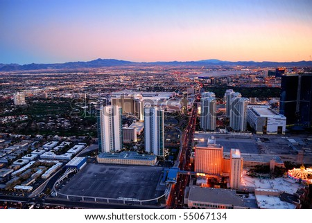 LAS VEGAS - MAR 4: Vegas Strip, 3.8 mile stretch featured with world class hotels and casino, aerial view at dusk on March 4, 2010 in Las Vegas, Nevada. - stock photo