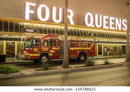 LAS VEGAS - MARCH 23: Firetrucks are on alert as throngs of visitors visit the Fremont Street Experience during March Madness in downtown Las Vegas on March 23, 2013. - stock photo