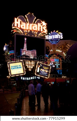 LAS VEGAS - MARCH 20: Harrah`s neon sign and Las Vegas nightlife  on March 20,2011. Opened in 1973 as the Holiday Casino, the property was renamed  Harrah's in 1992. - stock photo
