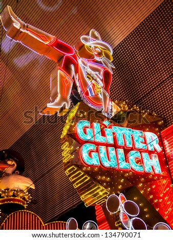 LAS VEGAS - MARCH 23:  March Madness generates frenetic activity along popular Fremont Street, also known as Glitter Gulch,  in downtown Las Vegas on March 23, 2013. - stock photo