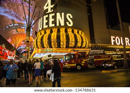 LAS VEGAS - MARCH 23:  March Madness generates frenetic activity along popular Fremont Street in downtown Las Vegas on March 23, 2013. - stock photo