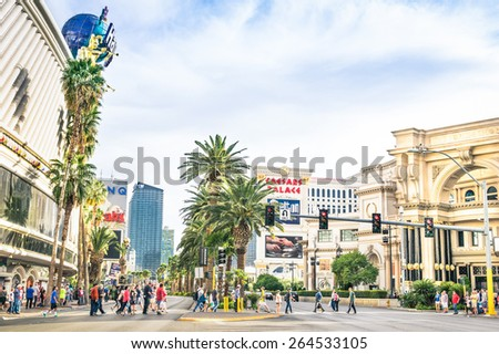LAS VEGAS - MARCH 23, 2015: multiracial people walking on The Strip, the world famous Las Vegas Boulevard South, mostly known for its concentration of resort hotels and casinos along the street route. - stock photo