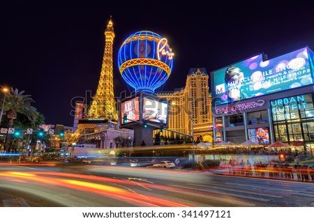 LAS VEGAS - MARCH 26 : View of the strip on March 26 , 2015 in Las Vegas. Paris Las Vegas hotel and Casino sign in the shape of the Montgolfier balloon with the theme of Paris in France  - stock photo
