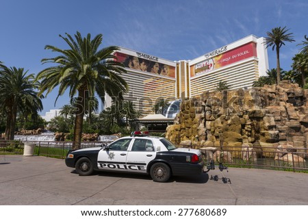 LAS VEGAS - MAY 7, 2015 - A metro Las Vegas police car sits on the sidewalk of the Mirage Hotel and casino making their presence known. - stock photo