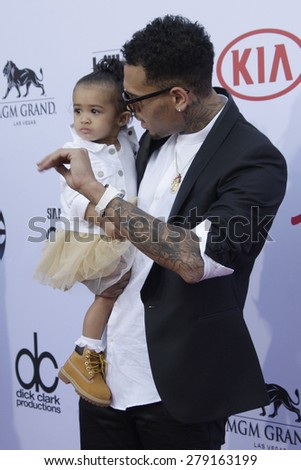 LAS VEGAS - MAY 17:  Chris Brown, his baby at the Billboard Music Awards 2015 at the MGM Garden Arena on May 17, 2015 in Las Vegas, NV - stock photo