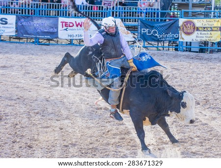 LAS VEGAS - MAY 17 : Cowboy Participating in a Bull riding Competition at the Helldorado days Rodeo , A professional Rodeo held in Las Vegas , Nevada on May 17 , 2015 - stock photo