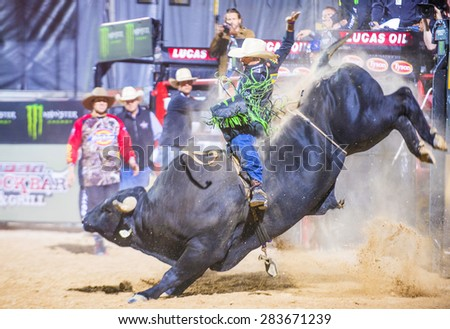LAS VEGAS - MAY 23 : Cowboy Participating in a Bull riding Competition at the Las Cowboy Standing , a cometition with the fifty of the top bull riders in the world held in Las Vegas on May 23 , 2015 - stock photo