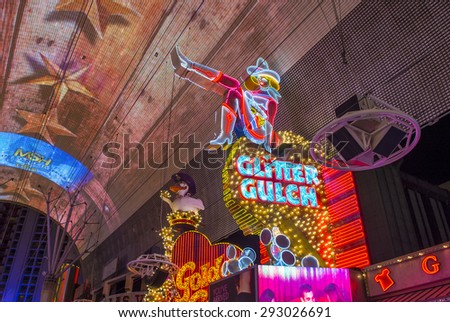 LAS VEGAS - MAY 17 : Cowgirl neon sign in downtown Las Vegas on May 17 2015. The iconic sign of Glitter Gulch is placed in 20 East Fremont Street, in Downtown Las Vegas - stock photo