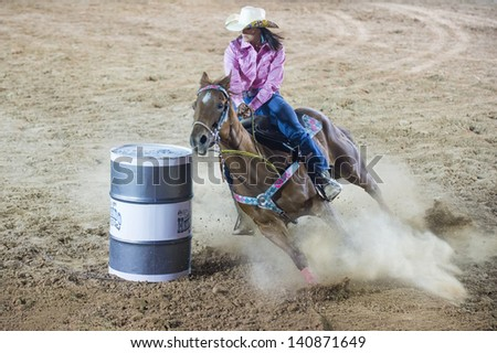 LAS VEGAS - MAY 17 : Cowgirl Participant in a Barrel racing competition at the Helldorado Days Professional Rodeo in Las Vegas , USA on May 17 2013 - stock photo
