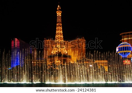 "LAS VEGAS-MAY 02: Dancing musical fountains of the Bellagio Hotel on Eiffel Tower of hotel ""Paris"" background, May 02, 2007."