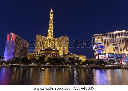 """LAS VEGAS - MAY 20, 2013 - Las Vegas Strip on May 20, 2013  in Las Vegas. Nevada has Spent Millions over the past few years to come up with a new slogan. """"Nevada: A World Within. A State Apart"""" - stock photo"""