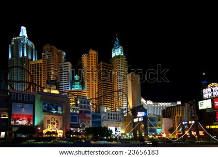 LAS VEGAS - MAY 1, 2007: Life continues at night. Illumination of  New York Hotel & Casino on May 1, 2007 in Las Vegas, Nevada. The hotel skyline architecture simulates the real New York City skyline.