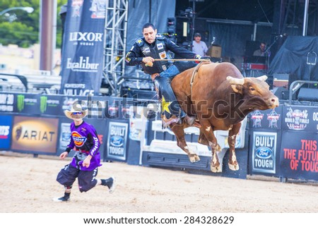 LAS VEGAS - MAY 23 : Number one Bull rider in the world  Joao Ricardo Vieira Participating in a Bull riding Competition at the Las Cowboy Standing , a PBR cometition held in Las Vegas on May 23 2015 - stock photo