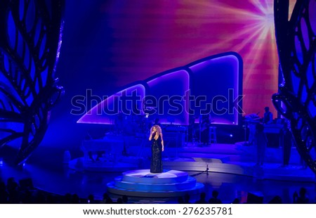 LAS VEGAS - MAY 06 : Singer Mariah Carey performs during the launch of her residency 'MARIAH 1 TO INFINITY' at The Colosseum at Caesars Palace on May 6, 2015 in Las Vegas, Nevada.
