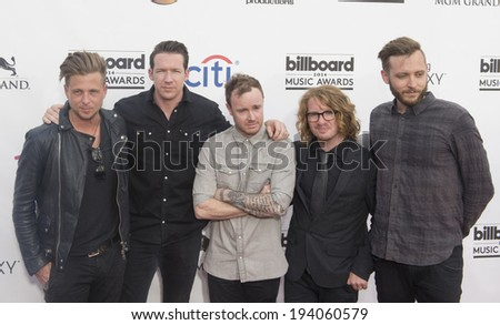 LAS VEGAS - MAY 18 : Singer Ryan Tedder (L) and One Republic bandmates attend the 2014 Billboard Music Awards at the MGM Grand Garden Arena on May 18, 2014 in Las Vegas. - stock photo