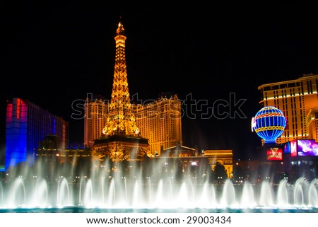 LAS VEGAS - MAY 2: The musical fountains on Eiffel Tower of Hotel Paris background on May 2, 2007 in Las Vegas, Nevada. Paris opening date was September 1, 1999. Paris cost USD $785 million to build, and occupies 24 acres - stock photo