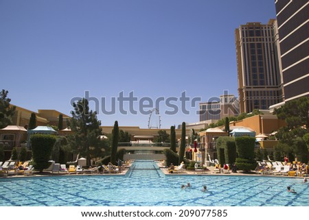 LAS VEGAS - MAY 12: The pool at The Wynn Encore Casino on May 12, 2014 in Las Vegas. The US$2.7 billion resort is named after casino developer Steve Wynn - stock photo