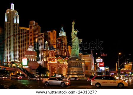 LAS VEGAS - MAY 1: Traffic moves past the New York, New York Hotel & Casino on May 1, 2007 in Las Vegas. The hotel opened on January 3, 1997 as a joint venture of MGM and Primadonna Resorts. - stock photo