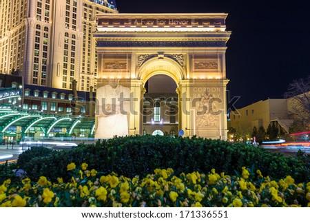 LAS VEGAS, NEVADA - DECEMBER 24:  Arch of Titus at night with flower garden in Las Vegas, NV, on December 24, 2013. - stock photo