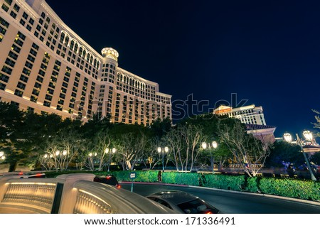 LAS VEGAS, NEVADA - DECEMBER 24: Bellagio Hotel and Casino at night with Caesars Palace in the background in Las Vegas, NV, on December 24, 2013. - stock photo
