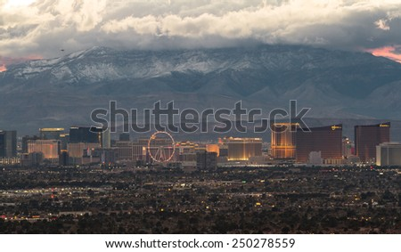 Las Vegas Nevada - December 13 : Hotels in the Las Vegas Strip at sunset with low clouds over the mountain, December 13 2014 in Las Vegas, Nevada - stock photo