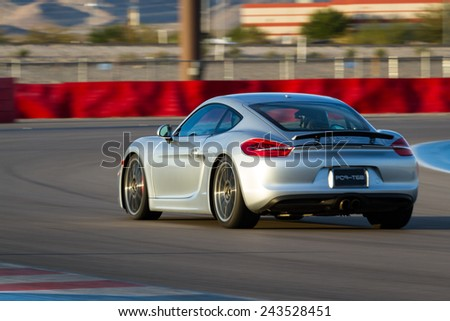 Las Vegas Nevada - December 09 : Porsche Cayman S going around the track at the Las Vegas Motor Speedway , December 09 2014 in Las Vegas, Nevada - stock photo