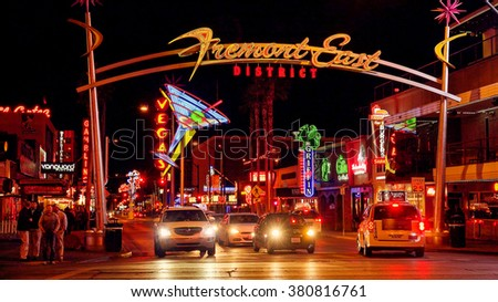 LAS VEGAS, NEVADA - FEBRUARY 5:  Bright neon lights and traffic at the Fremont Street Experience in Las Vegas, Nevada on February 5th, 2016. - stock photo