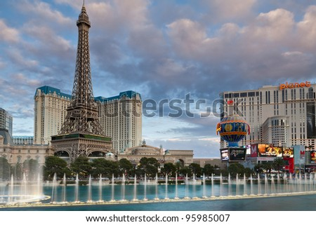 LAS VEGAS, NEVADA - FEBRUARY 11: Hotel Paris with half scale, 541-foot (165 m) tall replica of the Eiffel Tower at twilight on February 11, 2012 in Las Vegas, Nevada. - stock photo