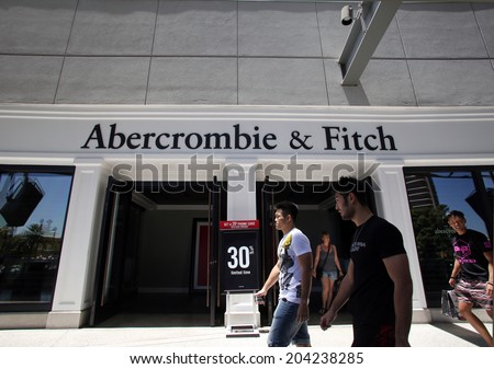 LAS VEGAS, NEVADA - FRI. JUNE 27, 2014:  Shoppers walk past an Abercrombie & Fitch clothing store in Las Vegas, Nevada, on Friday, June, 27, 2014.  - stock photo