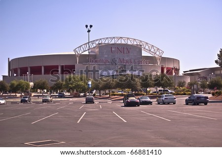 LAS VEGAS, NEVADA - JANUARY 6:  People gather early for a January 6, 2009 UNLV basketball game at the Las Vegas Thomas & Mack Center, a venue for basketball games, concerts, and other events. - stock photo