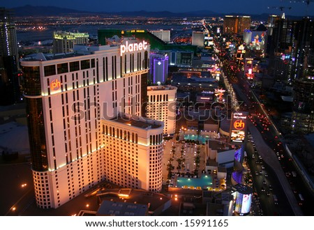 LAS VEGAS, Nevada - June 7 2008: Planet Hollywood Hotel Casino in the foreground of Las Vegas Boulevarde just after sunset as the city gears up for another night.