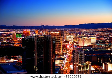 LAS VEGAS, NEVADA - MARCH  3,  Las Vegas strip skyline at sunset with hotel illuminated, March 3, 2010 in Las Vegas, Nevada. - stock photo