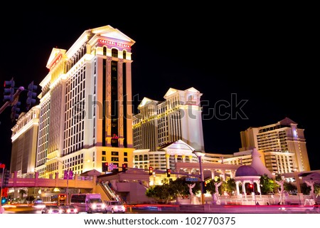 LAS VEGAS, NEVADA - MAY 7:  Caesar's Palace on the Vegas Strip in Las Vegas, Nevada on May 7, 2012.  This world class hotel opened in 1966,  continues to expand and currently has six towers. - stock photo
