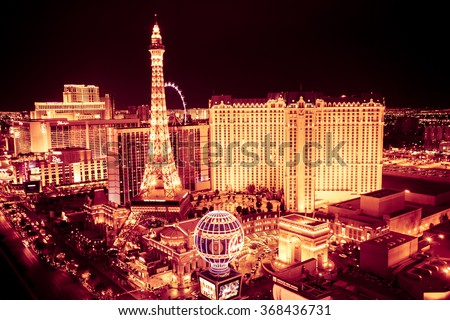 LAS VEGAS, NEVADA - MAY 7, 2014:  Golden Night of the Las Vegas with Paris Vegas Resort and Casino in view.  - stock photo