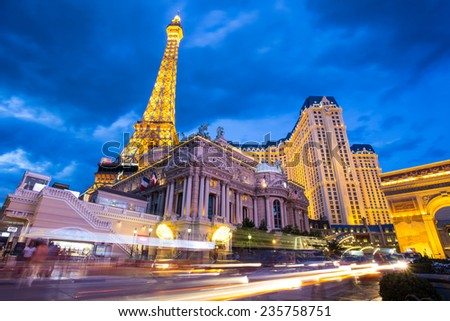 LAS VEGAS, NEVADA - MAY 7, 2014: Landmark Paris Hotel and Casino in Las Vegas, Nevada as seen at night. Stretching 4.2 miles, the Strip is home to the largest hotels and casinos in the world. - stock photo